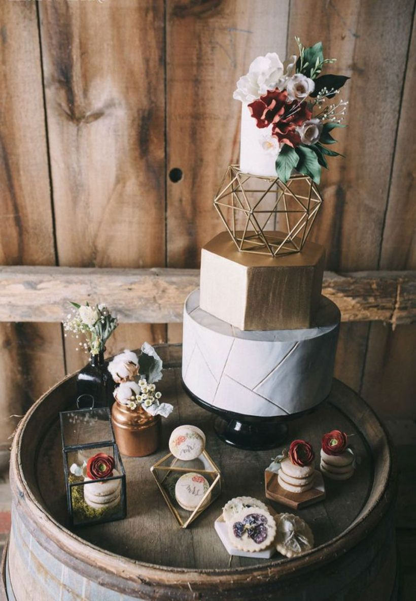 Gorgeous boho inspired wedding cake with flowers and rose gold modern geometric details