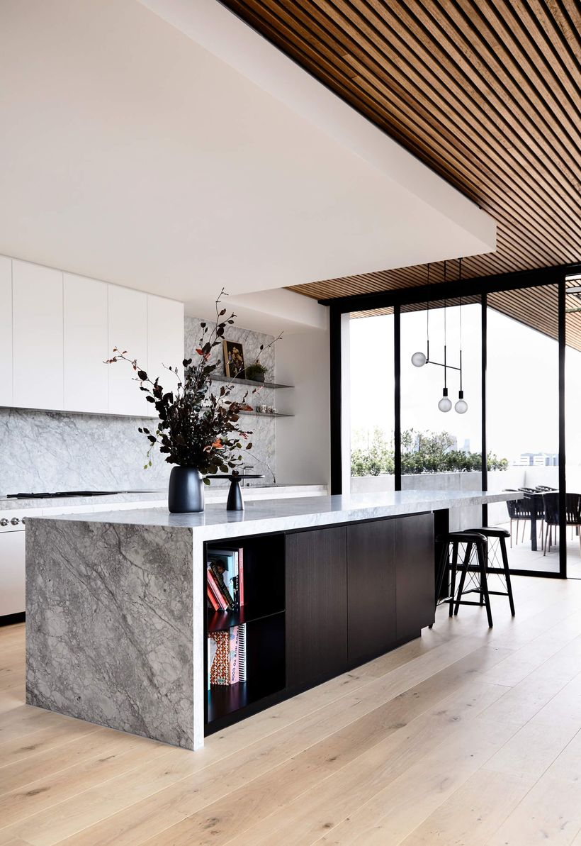 Long square gray countertop design on black cabinet