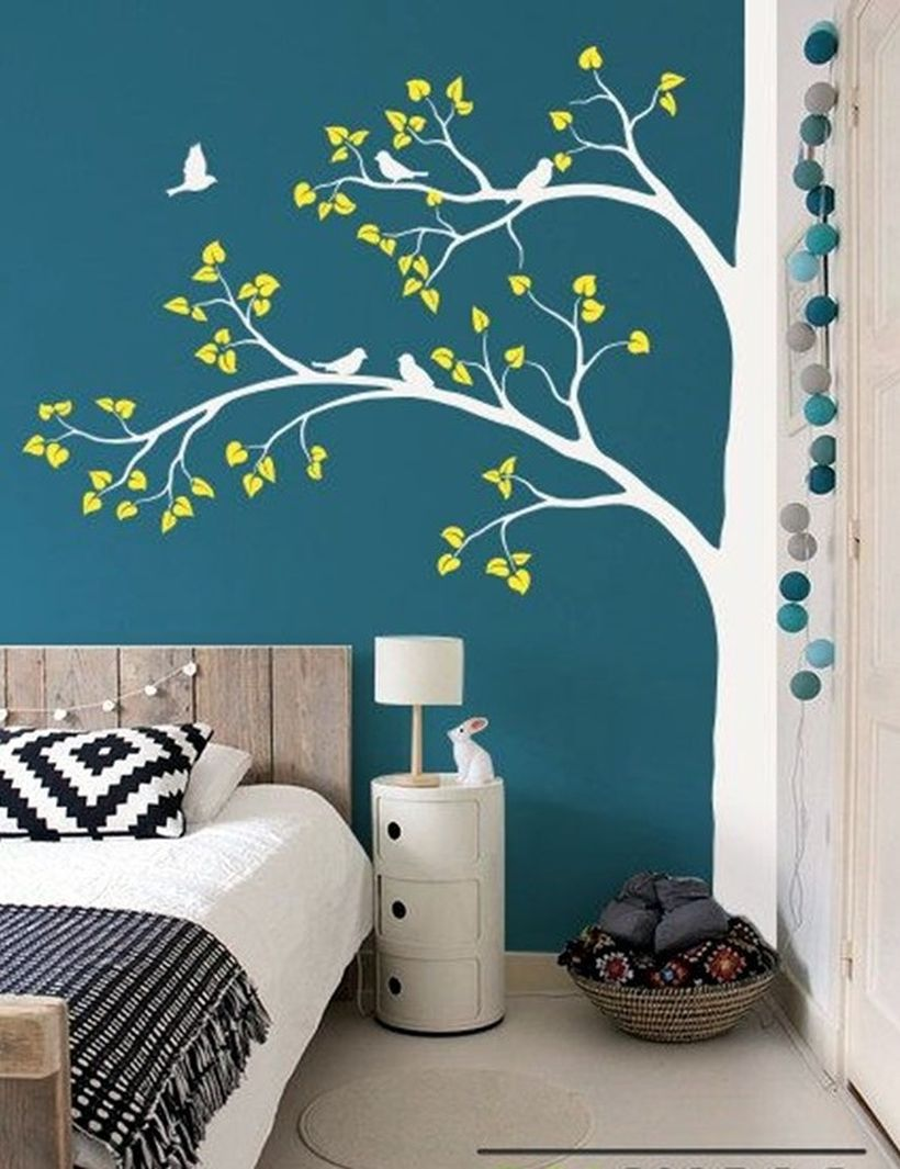 Minimalist bedroom design with wall painting sparrows and bird on the tree to create beautify your bedroom