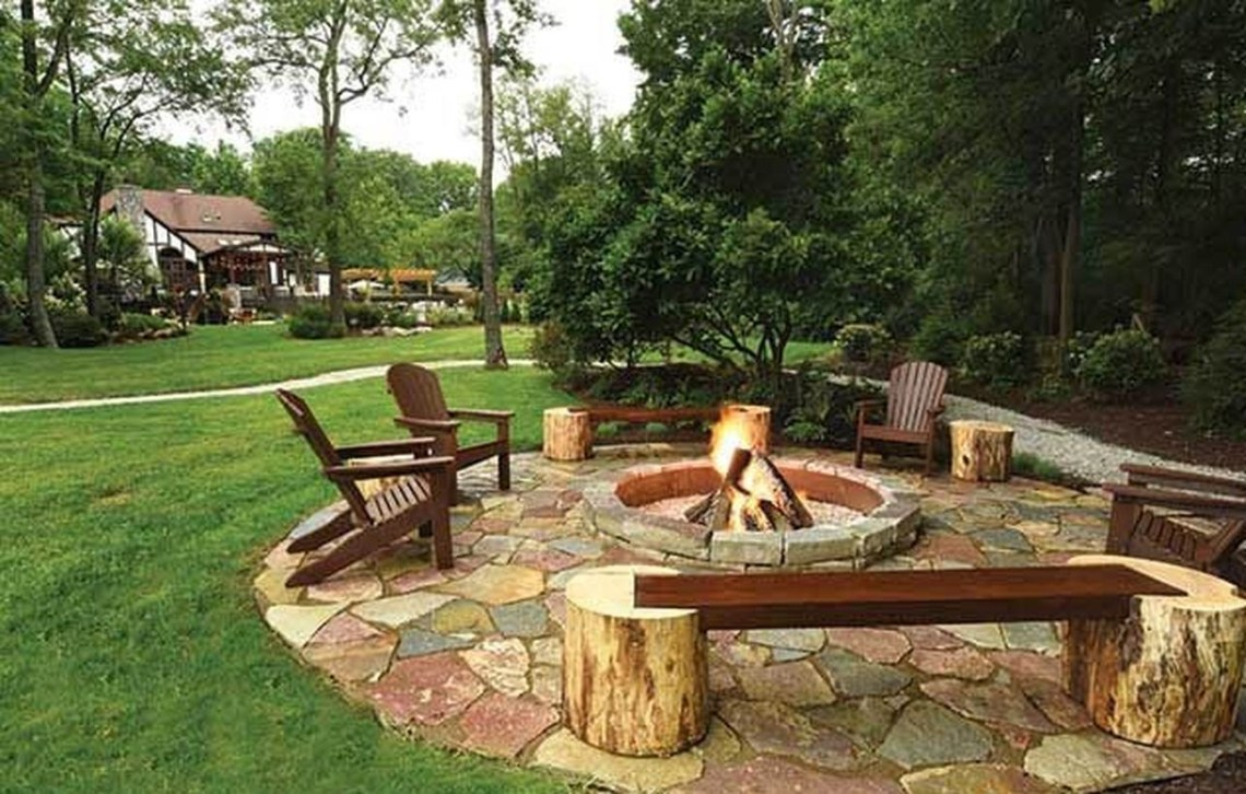 Outdoor fire pit with chunks of trees to sit