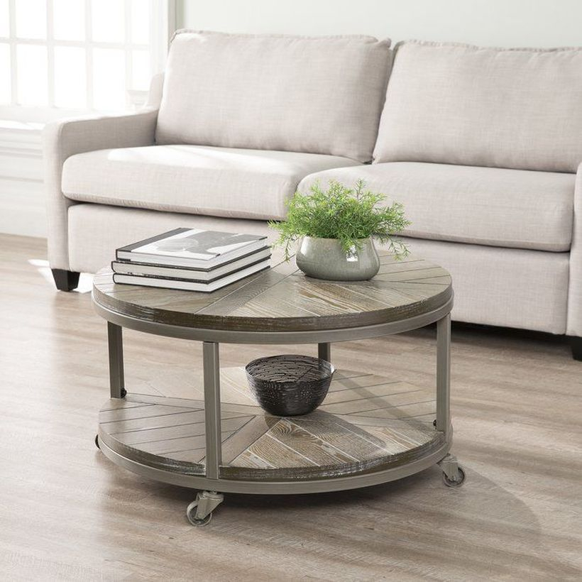 Round coffee table with wheel underneath