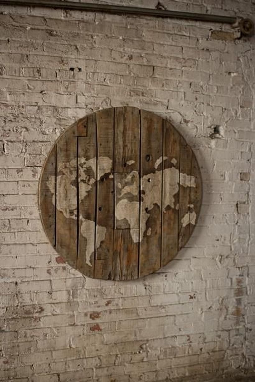 Round wooden pallet painted world map