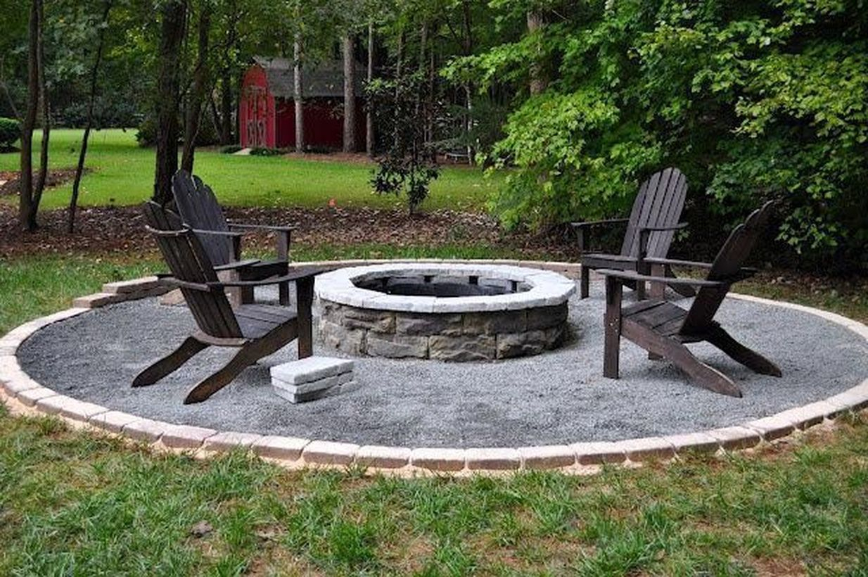 Stone fire pit with black wooden chair