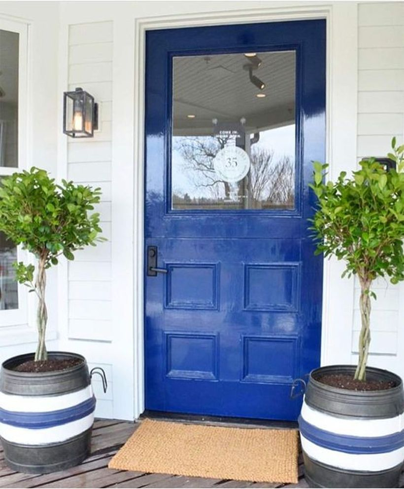 Striped planters with small trees for decoration front door you must try