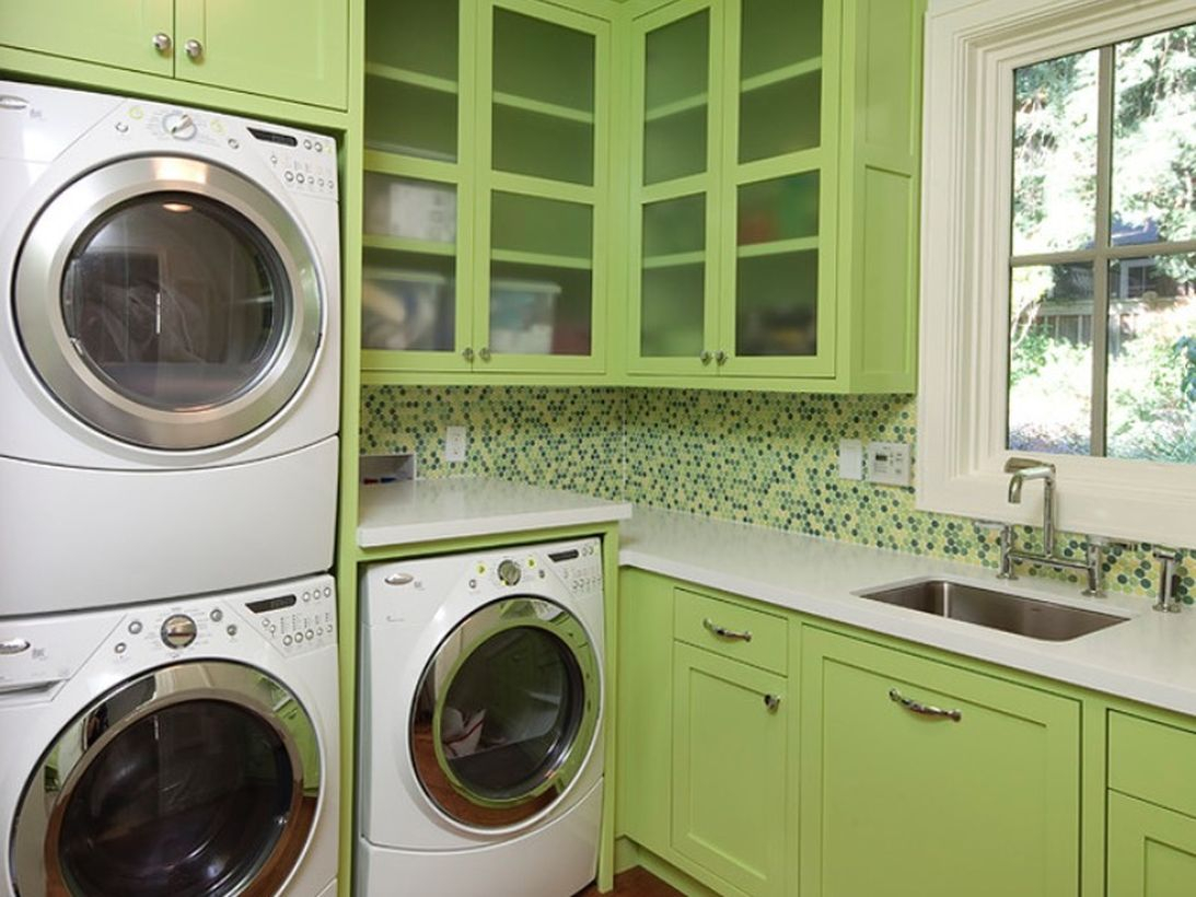 Washing machine with light green wooden cabinet storage
