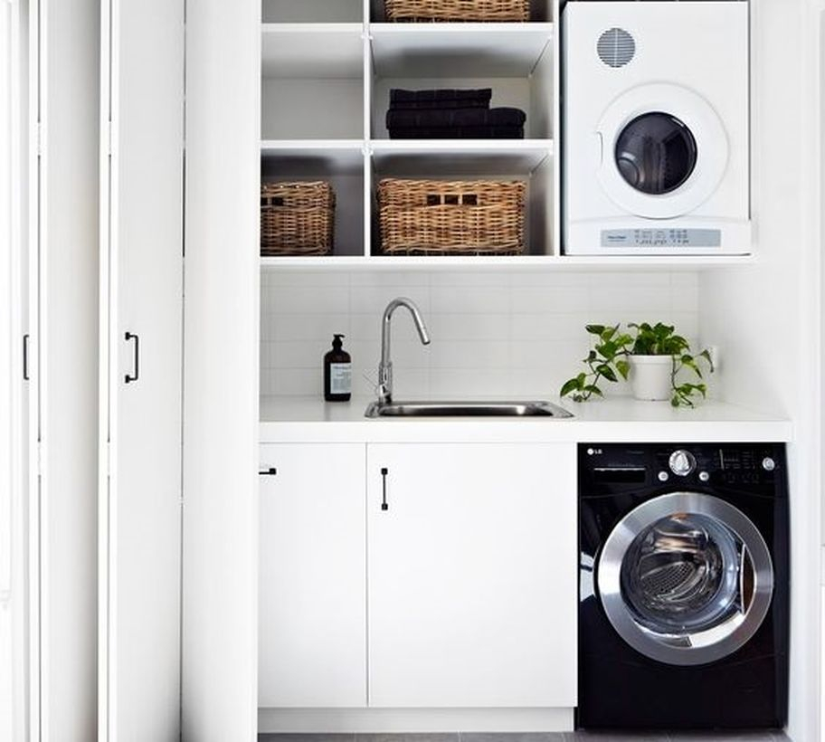White and black washing machine and rattan storage