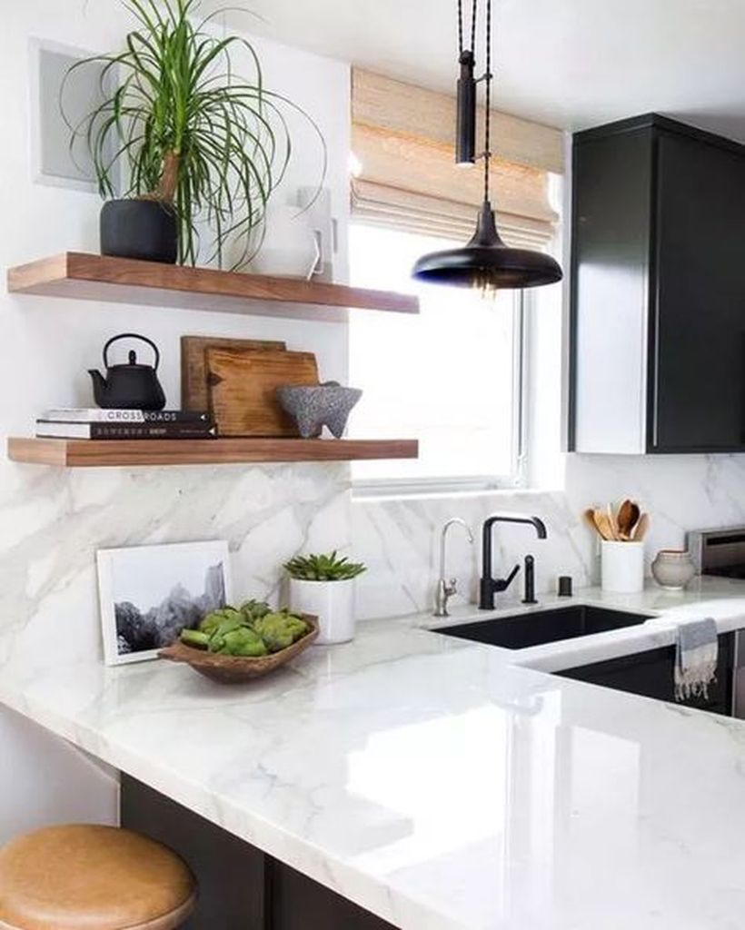 White countertop design with black and white sink