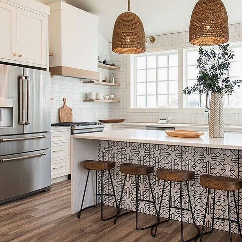 White countertop design with small wooden chairs