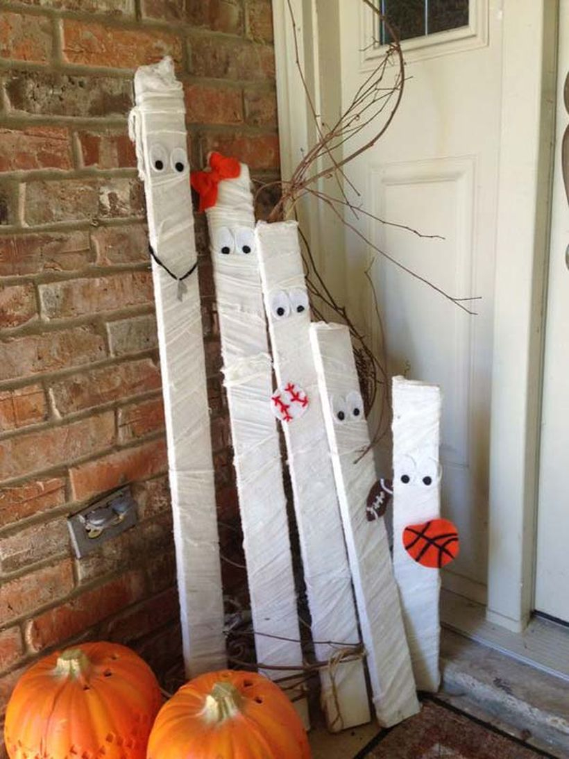 A halloween decoration made from recycled white wood and pumpkin decoration for your patio decor