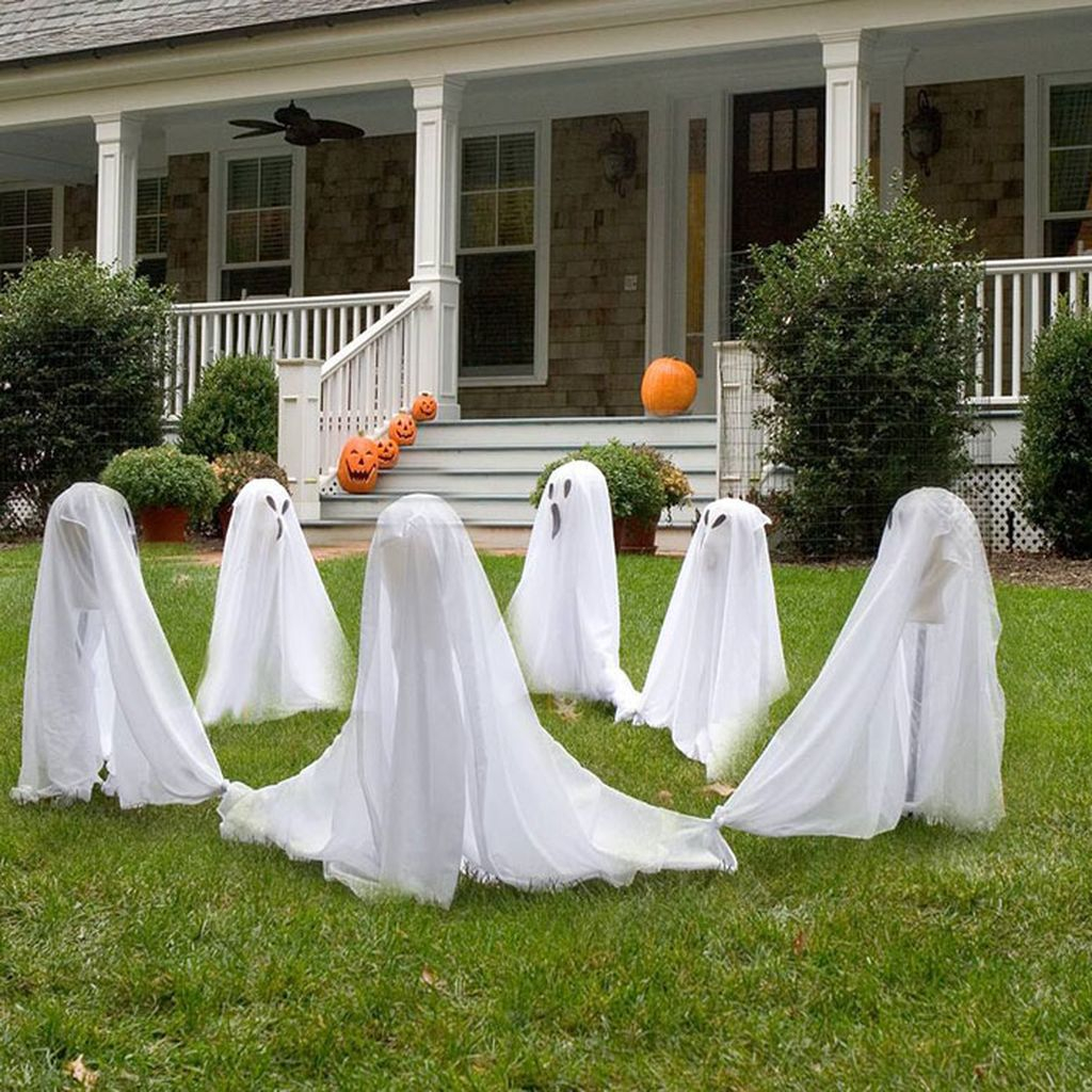 An amazing front yard decorating for halloween with ring around the ghosties to complete your spooky outdoor decoration