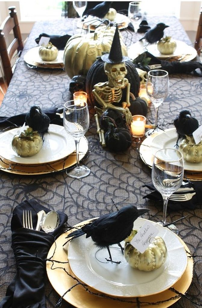 An incredible indoor decorations for halloween in dining room with skull in the middle to complete your decoration