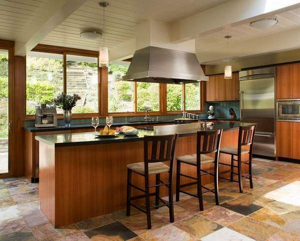 Classic kitchen flooring with wooden island table, wooden cabinet and wooden chairs