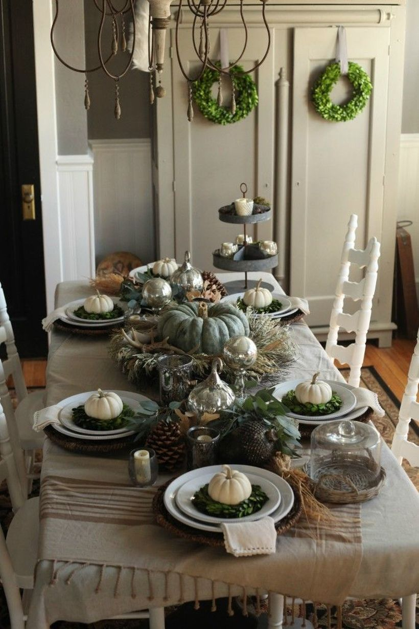 Dark-green-pumpkin-and-gray-tablecloth-for-thanksgiving-dinner.-