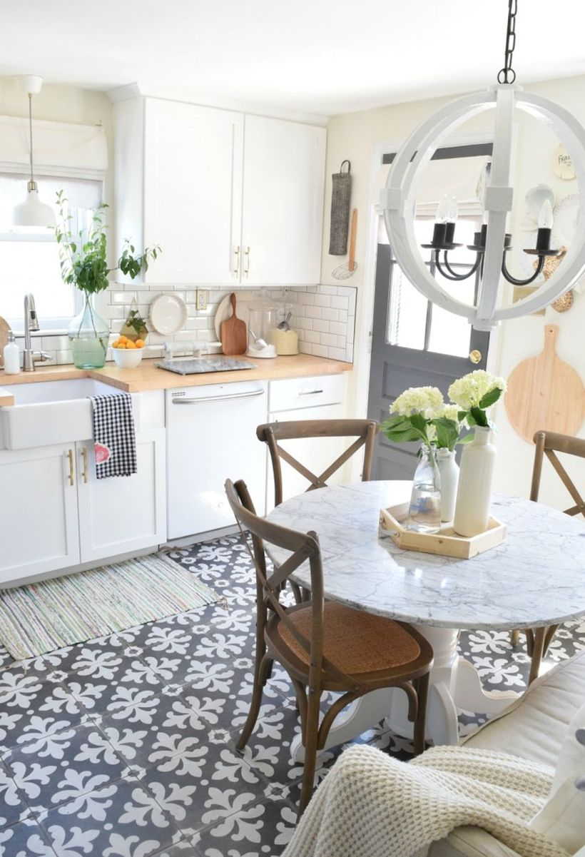 Kitchen floor white pattern in gray color combined with white cabinets, white round tables, wooden chairs and white round lamps