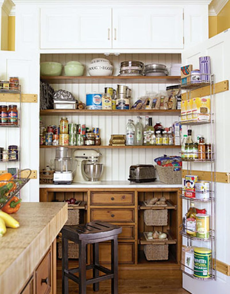 Kitchen pantry cabinet with wooden rack