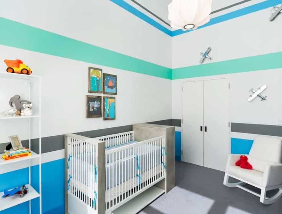 Large-baby-boys-nursery-room-with-white-and-blue-color-toy-airplane-attached-to-the-wall-and-tiered-storage-to-store-toy