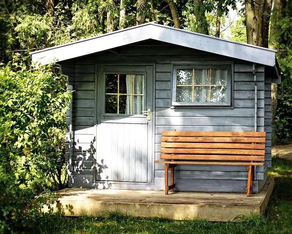 Log cabin garden shed in light blue