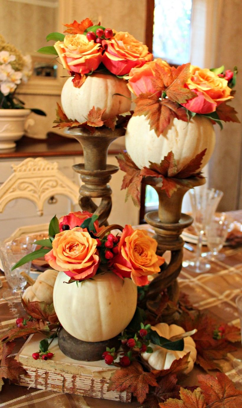 Patterned-tablecloth-and-white-pumpkin-and-red-yellow-flowers-
