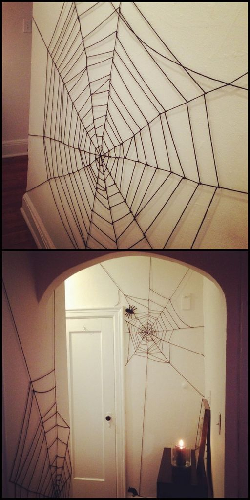 Perfect indoor decorations with yarn spider webs on the wall to complete your halloween decoration