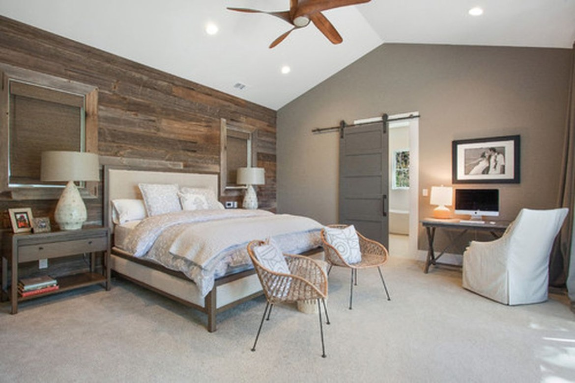 Simple bedroom with white bed, rattan chairs, and wooden wall decoration ideas