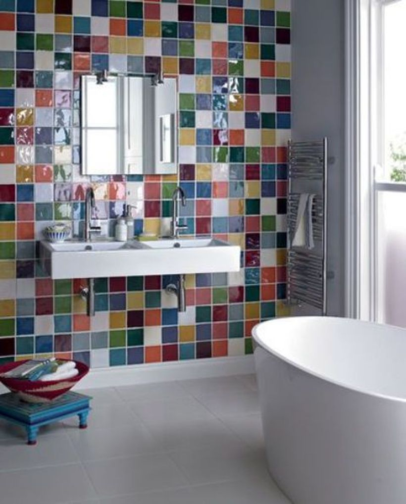 Small bedroom with colorful wall, white sink and white bathup for intresting decoration