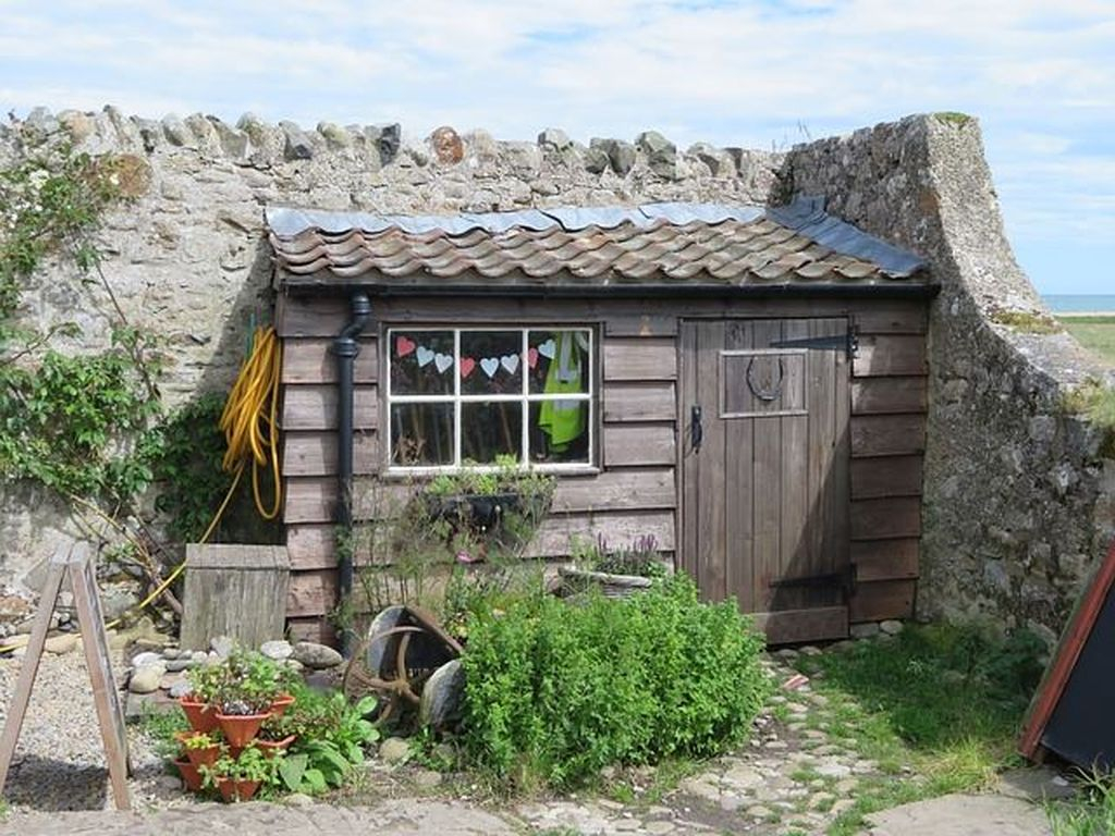 Small wooden shed to organize your home