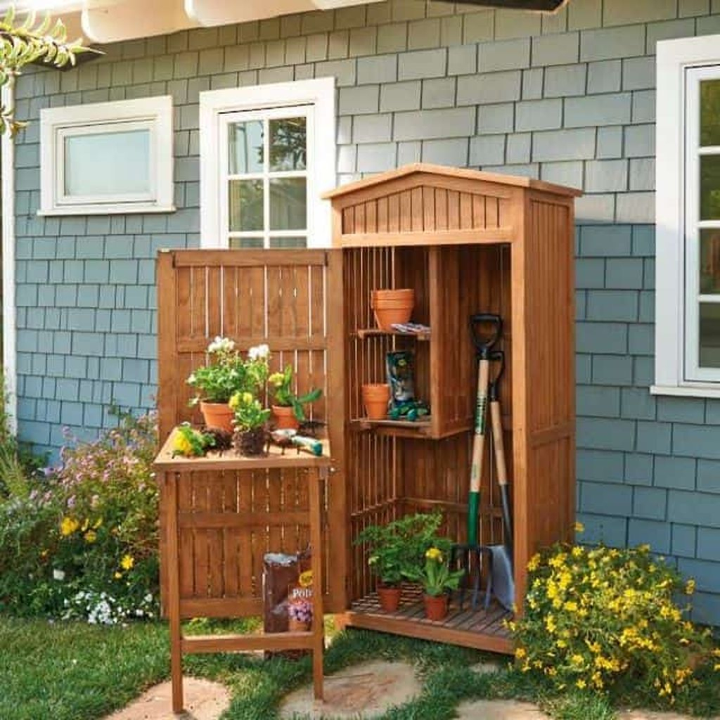 Teak storage shed for garden