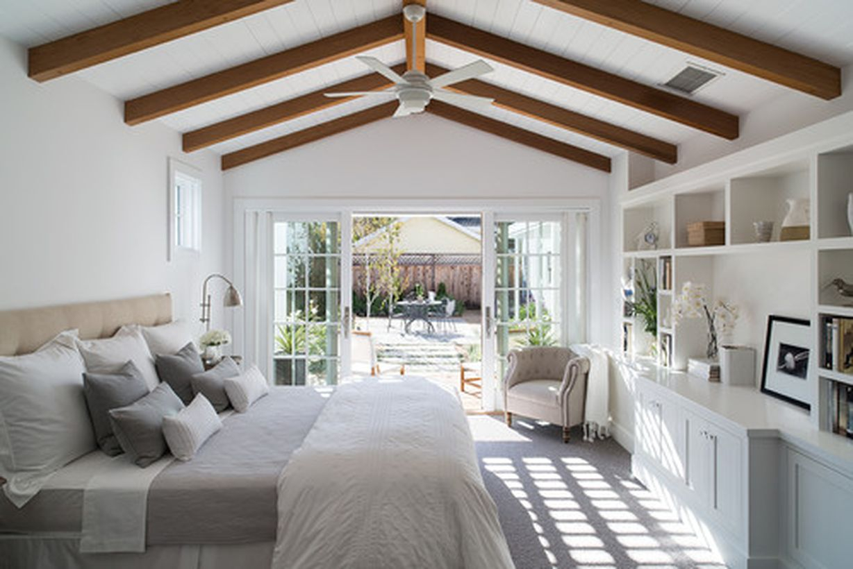 White bedroom with white bed, white pillow, and white wooden cabinet storage to look good