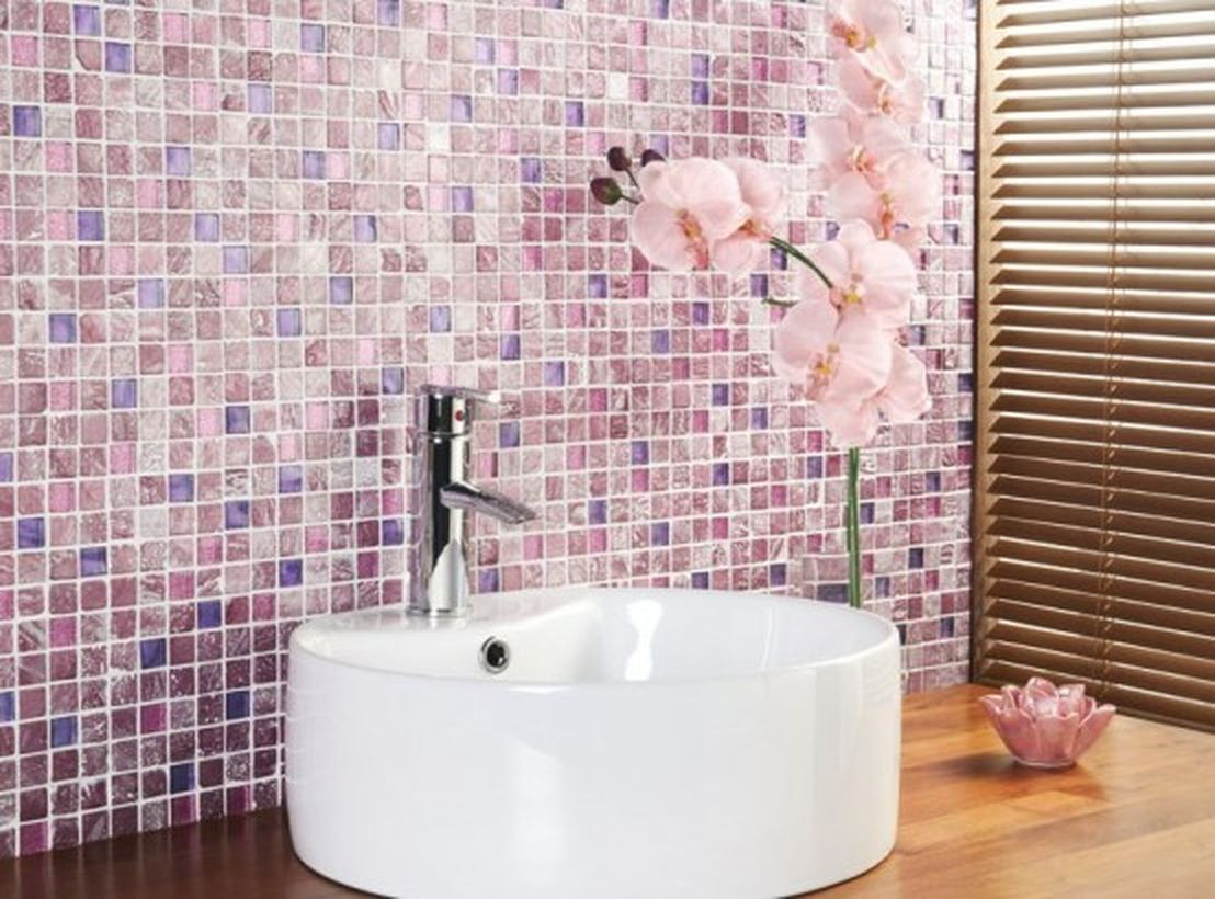 Wonderfull bedroom with pretty wall decoration combine with white sink and pink flowers to look stunning