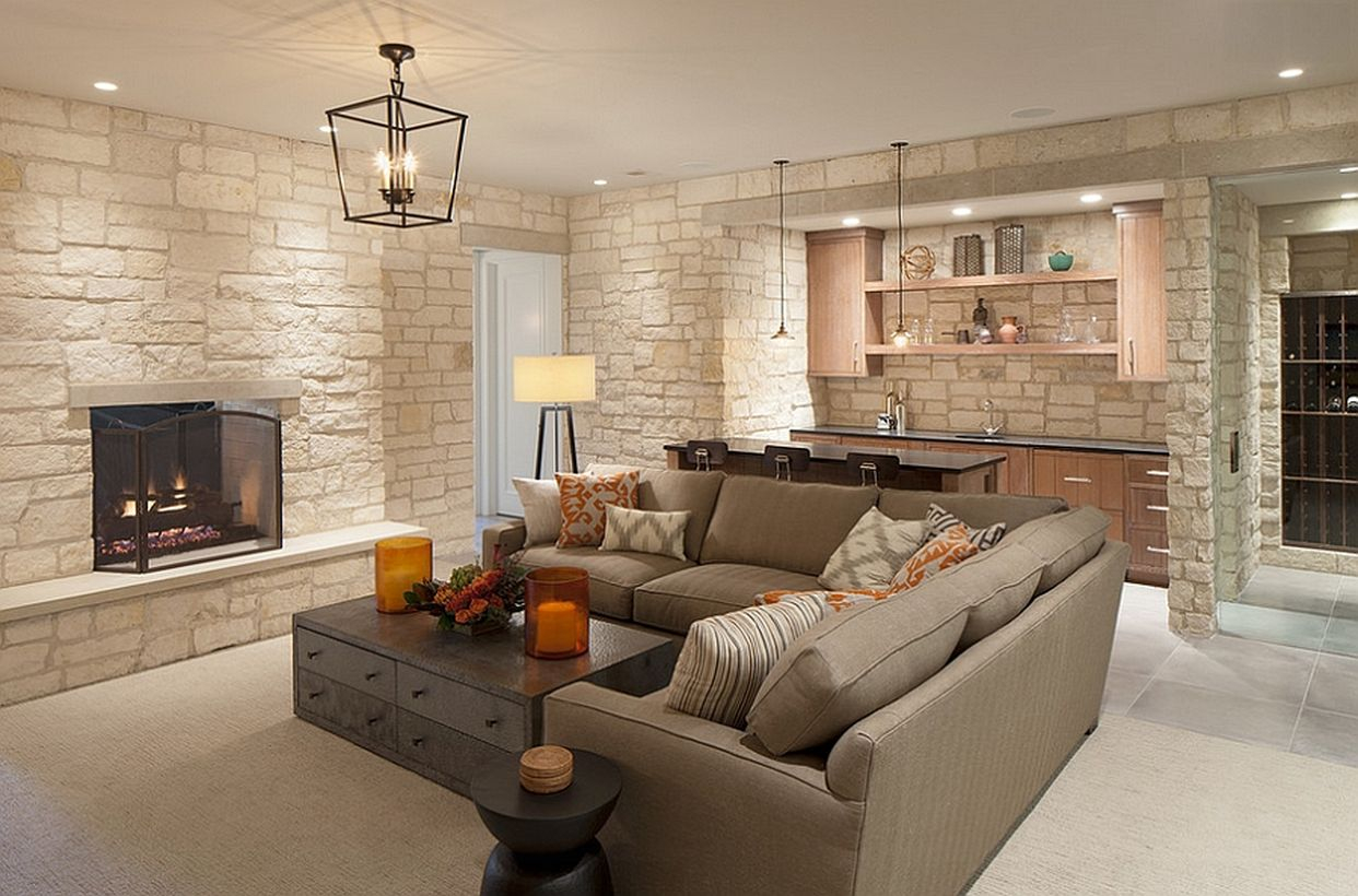 Basement hangout with bar, wine cellar, and gray latter l sofa