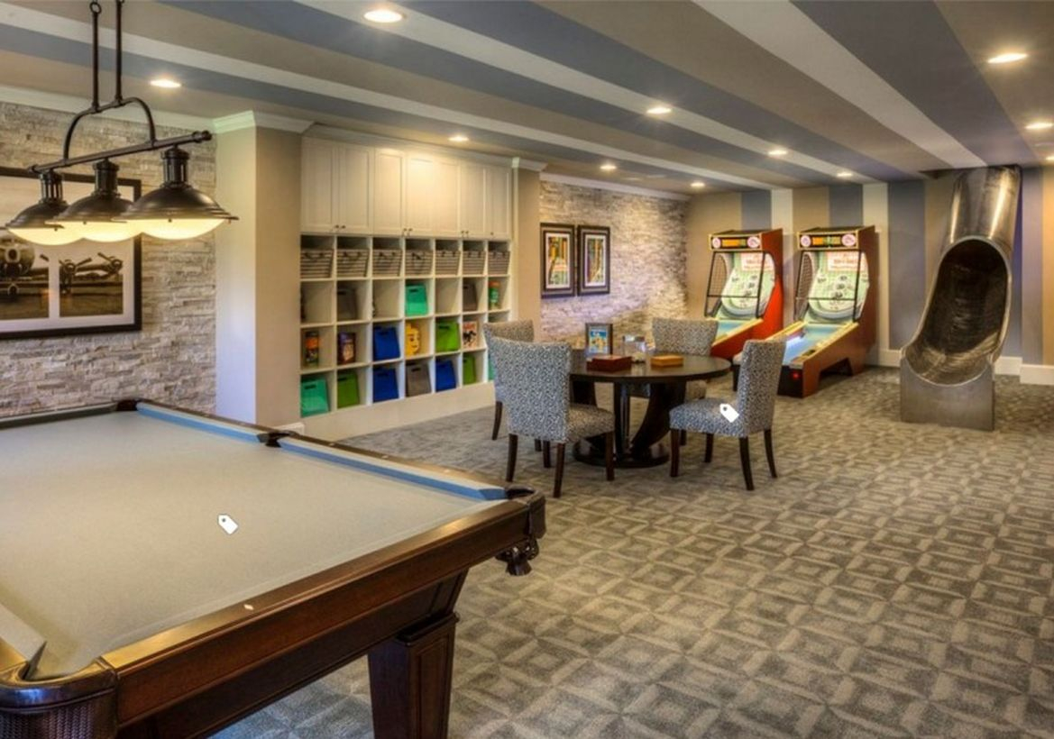 Basement with billiards and gaming areas