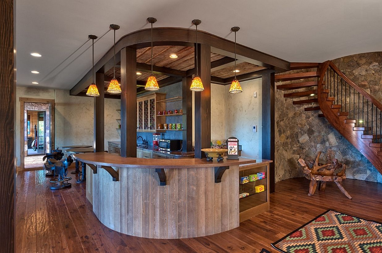Basement with wooden bar and hanging lamps