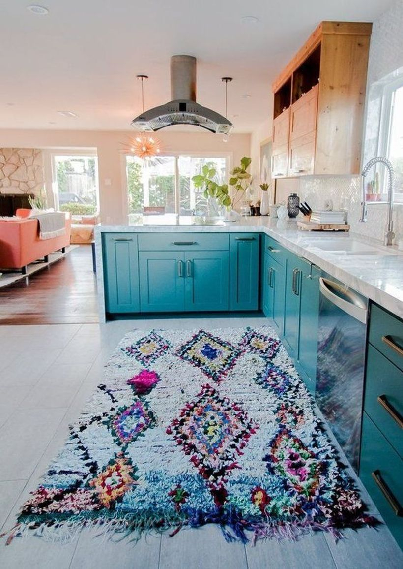 Boho pattern flooring in light blue color with blue wooden cabinet and white sink