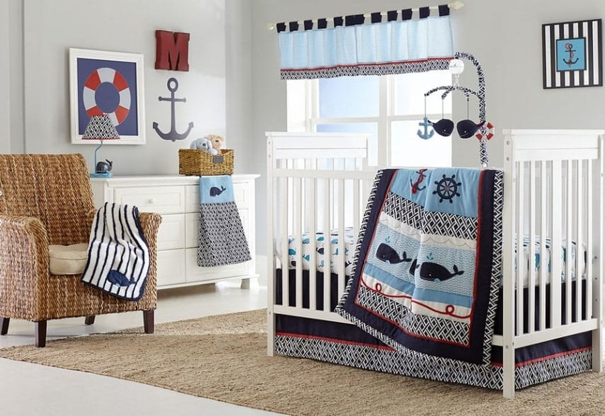 Cute-nursery-for-baby-boys-with-whale-themed-in-terms-of-blankets-bed-sheets-towels-and-toys-for-your-baby