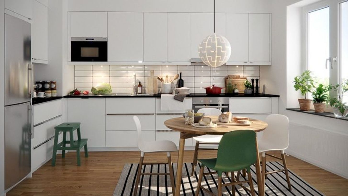 Scandinavian brown kitchen flooring with white cabinet, round wooden table and white black stripped carpet