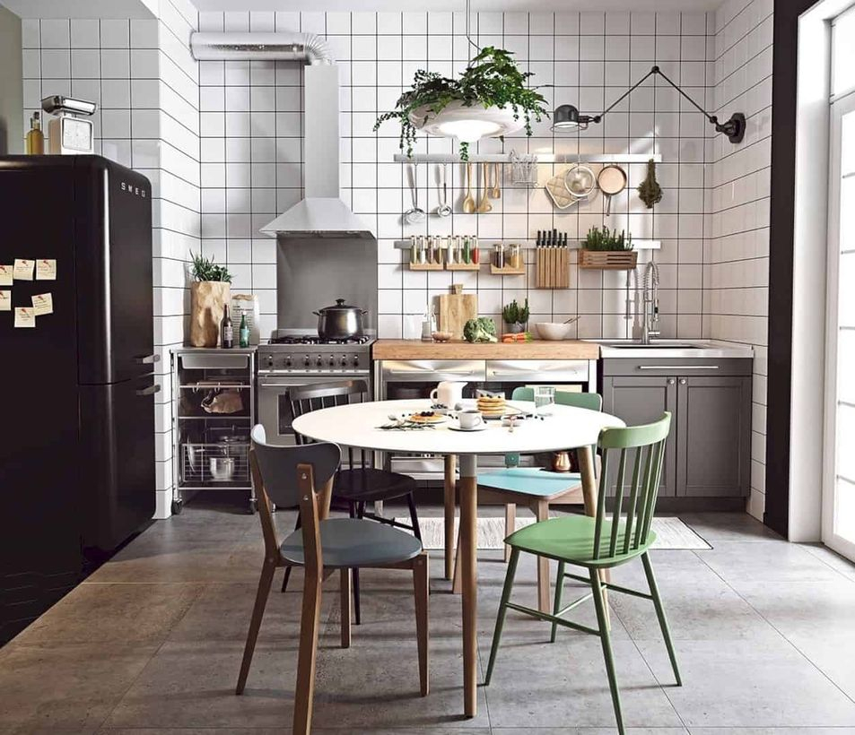 Scandinavian gray kitchen flooring with gray cabinet, round white table and green chairs