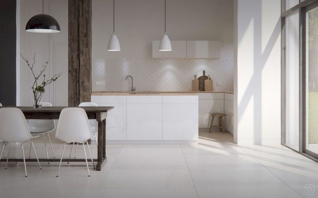 Scandinavian white kitchen flooring combine with white cabinet, square wooden table, white chairs and hanging white lamps