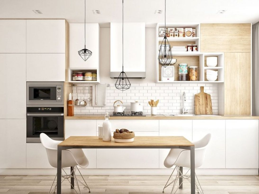 Scandinavianwhite wooden kitchen with white cabinet, square wooden table, white chairs and unique black hanging lamps