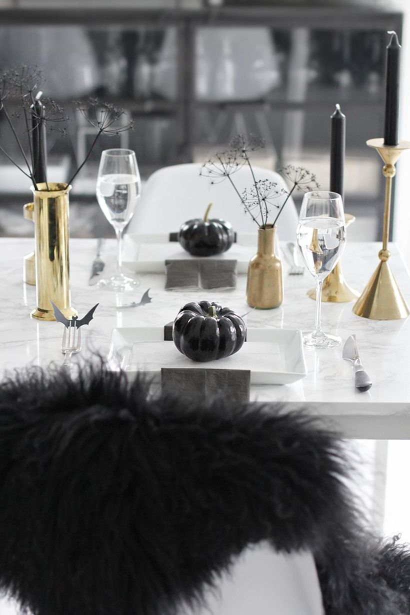 Scary halloween dining table with gold vases and candle holder