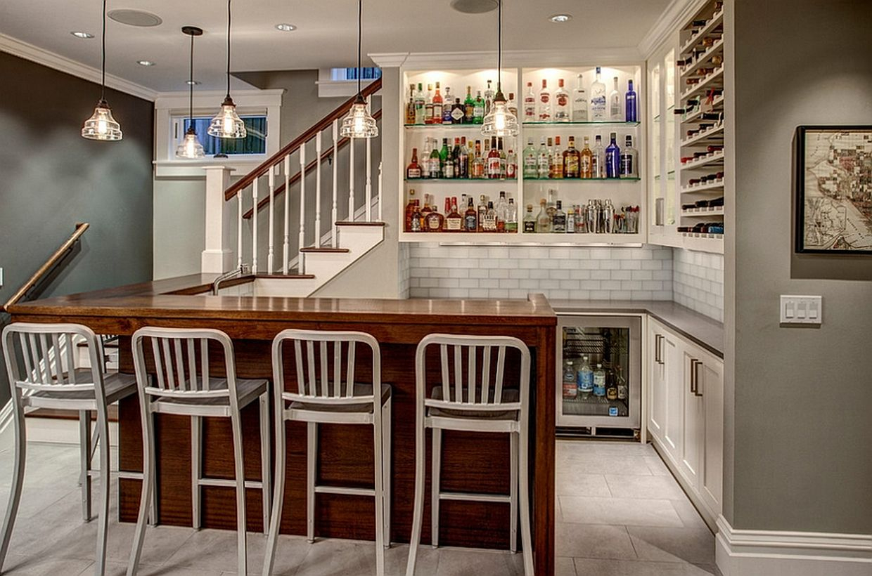 White basement with white bar, white walls, white chairs and wooden table
