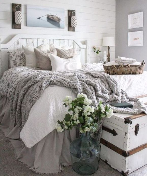 A-whitewashed-bed-and-walls-plus-a-chest-and-cozy-textiles.-1