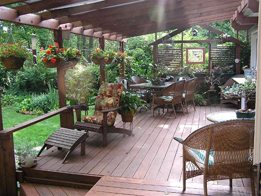 Backyard-patio-deck-design-with-a-greenery-arrangement-to-make-it-look-more-beautiful-and-provide-a-cool-environment