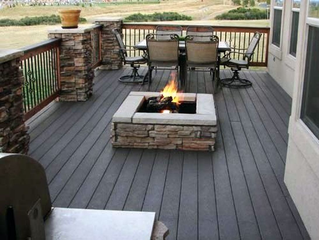 Backyard-patio-deck-with-fire-pit-to-warm-up-when-gathering-with-family