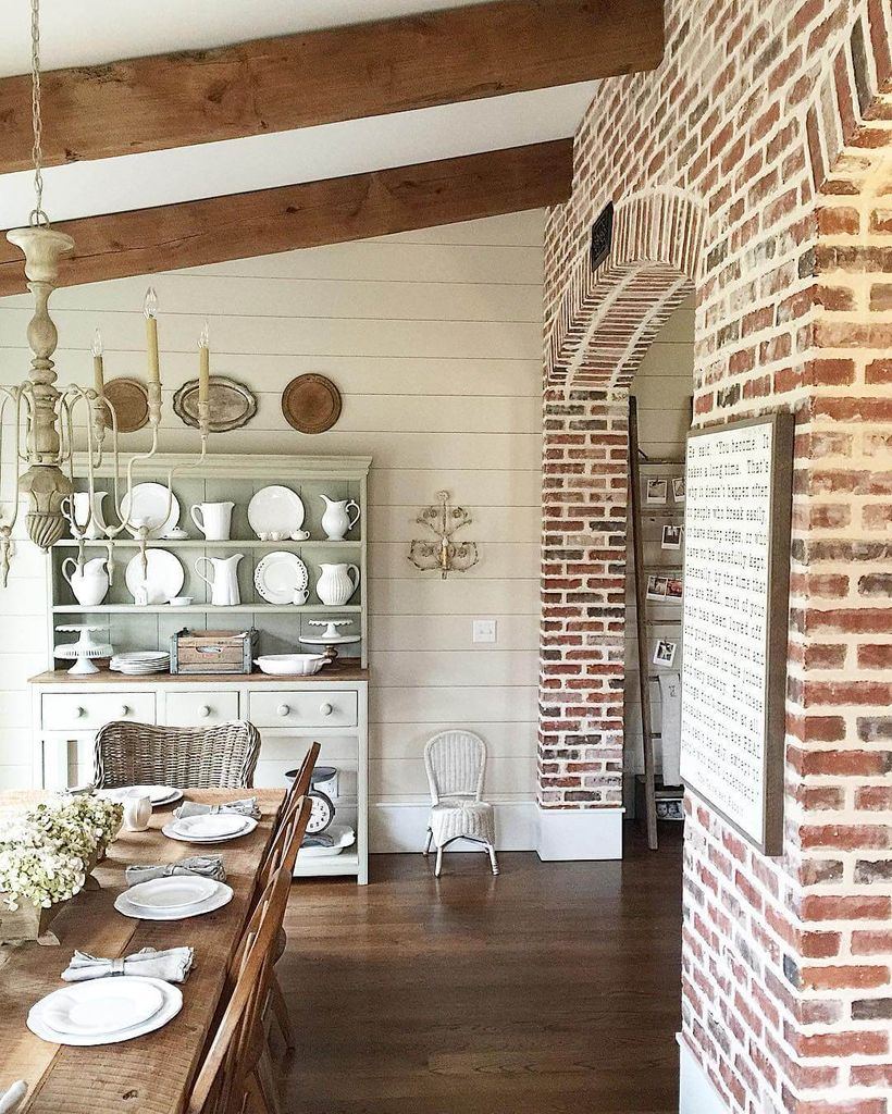Brick walls combined with wooden floor for farmhouse dining room