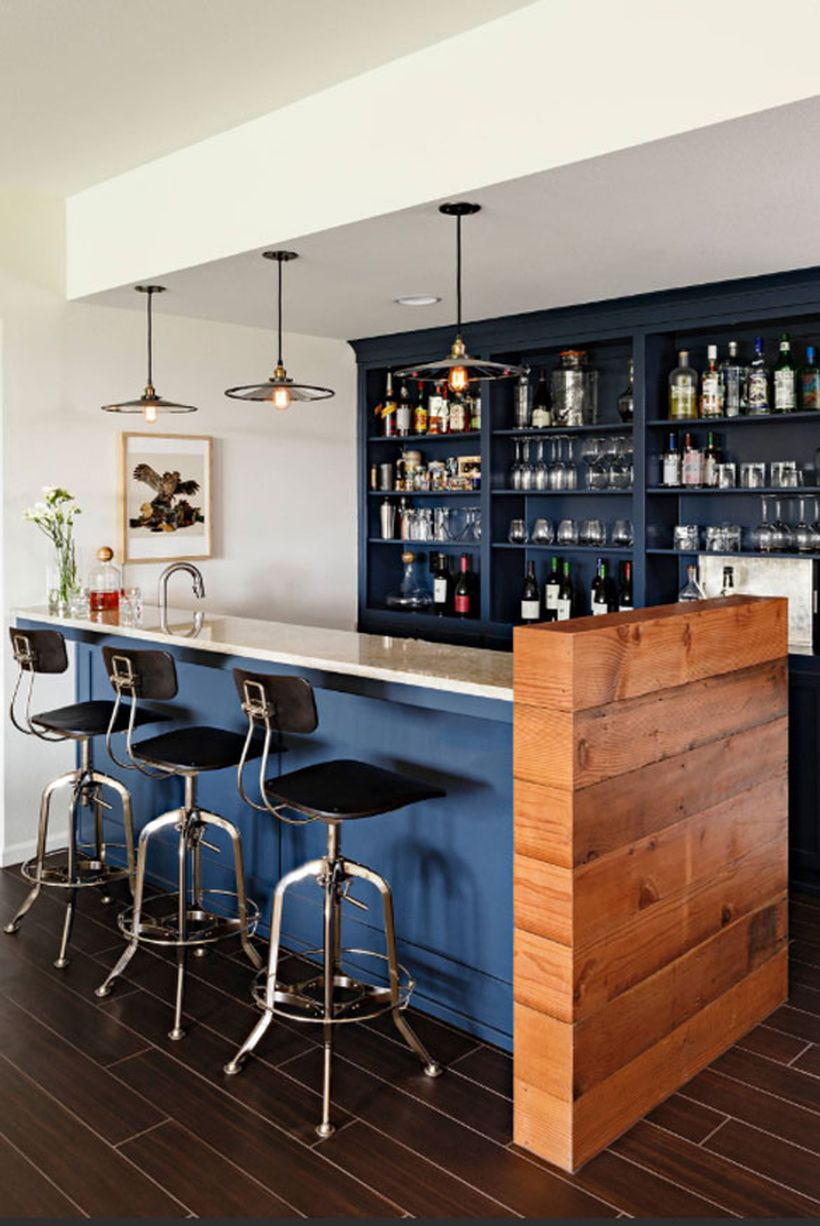 Dark blue coffee bar with blue table, small chairs and black chandelier to look amazing