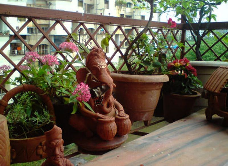 Decorative-plants-with-set-design-details-such-as-a-statue-lanterns-and-candlesticks-or-wall-hanging-colorful-pictures.-you-can-also-add-other-garden-accessories-that-will-suit-your-small-space.