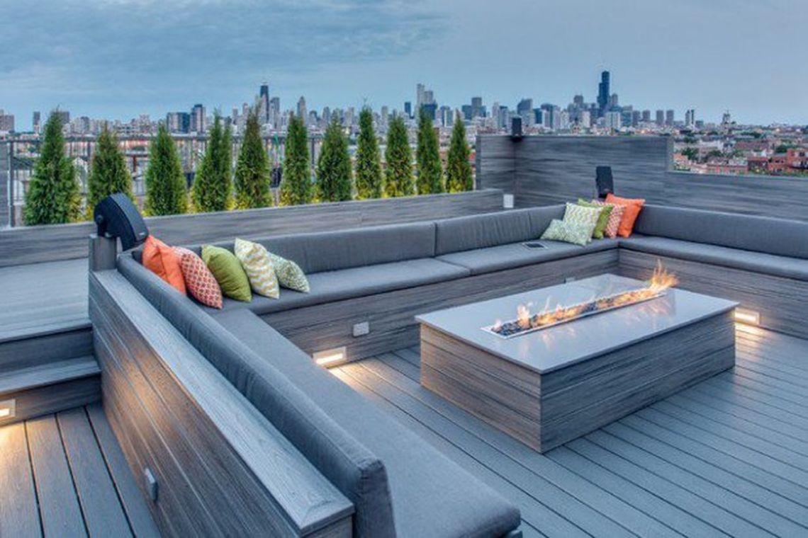 Elegant-fire-pit-on-a-big-table-and-long-sofa-to-relax-with-family-and-as-warmers-on-your-roof-top