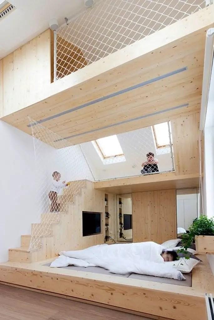Loft bedroom with wooden walls