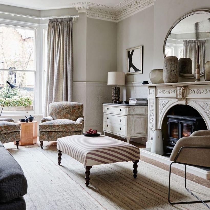 Neutral-color-scheme-living-room-with-paisley-print-sofa-and-rustic-cabinet-that-decorates-in-your-living-room