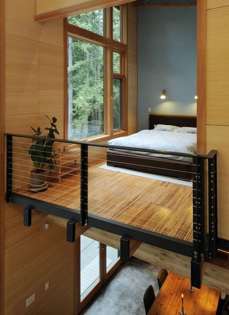 Small loft bedroom with wooden floor